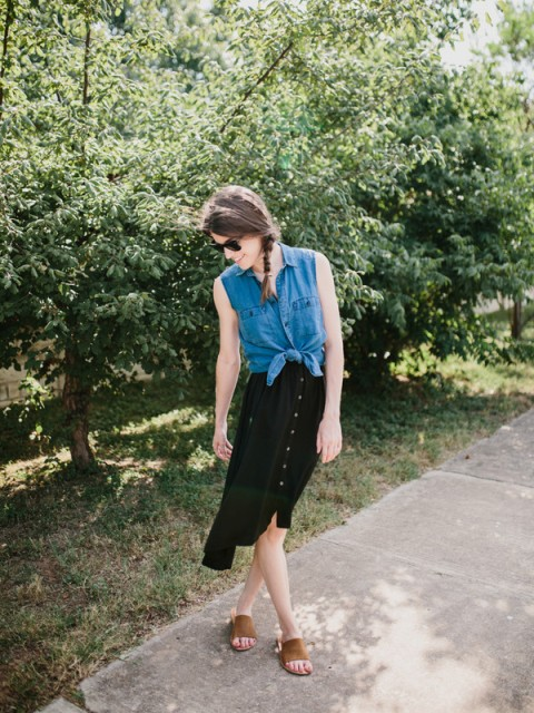 With black knee length skirt and brown sandals