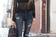 With black lace blouse, distressed jeans and suede boots
