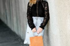 With black lace shirt, black shoes and brown bag
