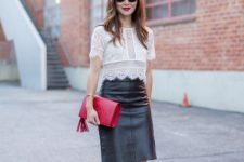 With black leather knee-length skirt, red pumps and red clutch