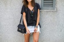 With black loose shirt, black and white shoes and black bag