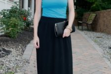 With black maxi skirt and black clutch