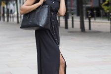 With black shirtdress and blue cutout shoes