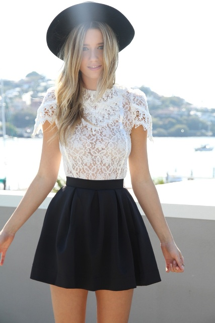 With black skater skirt and wide brim hat