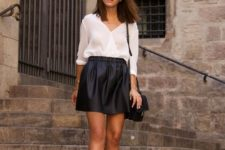 With black skater skirt, leather shoes and black bag