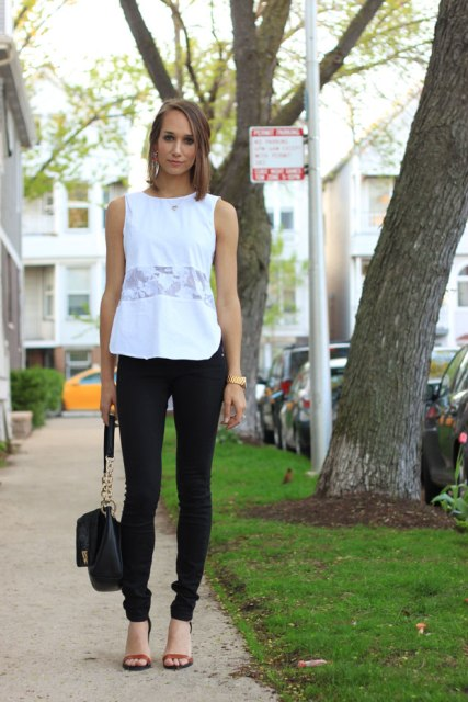 With black skinny pants, black bag and brown sandals