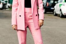 With black top, pale pink trousers and long blazer