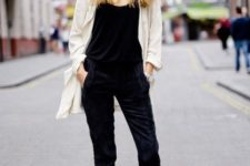 With black top, velvet pants and white blazer