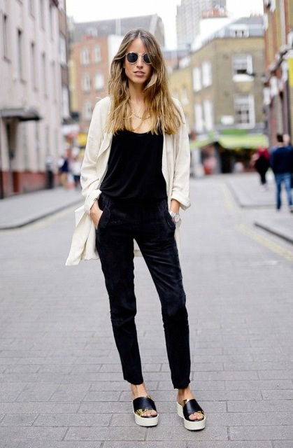 With black top, velvet pants and white blazer