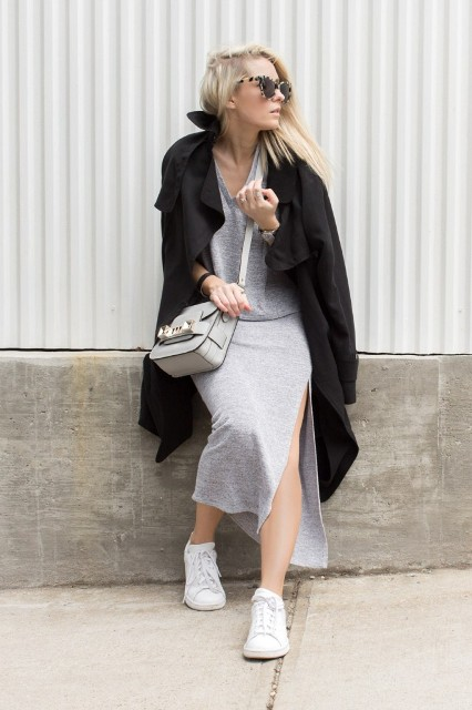 With black trench coat, gray crossbody bag and white shoes