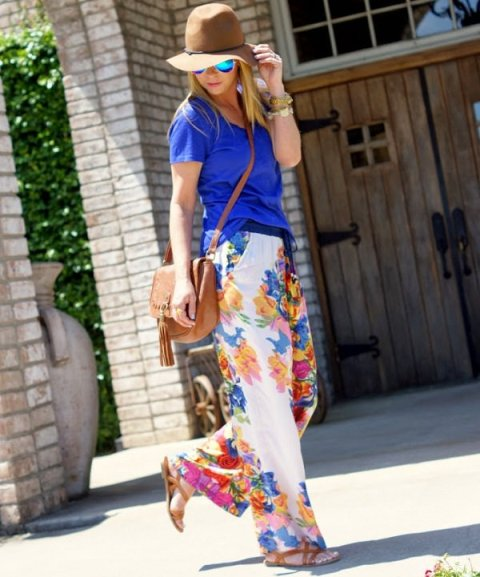 With blue t-shirt, wide brim hat, flat sandals and brown bag