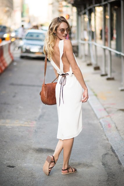 With brown bag and flat sandals