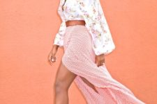 With brown belt, maxi printed skirt and beige pumps