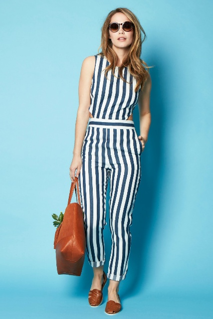 Striped jumpsuit with brown leather tote and brown flats