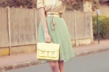 With button down shirt, mint green pleated skirt, yellow bag and orange shoes