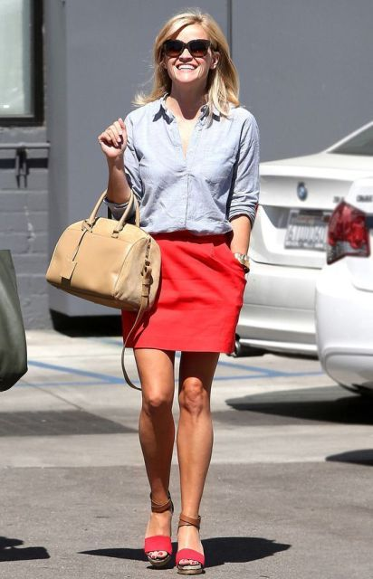 With button down shirt, red skirt and beige bag