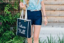 With checked shirt, navy blue shorts and tote