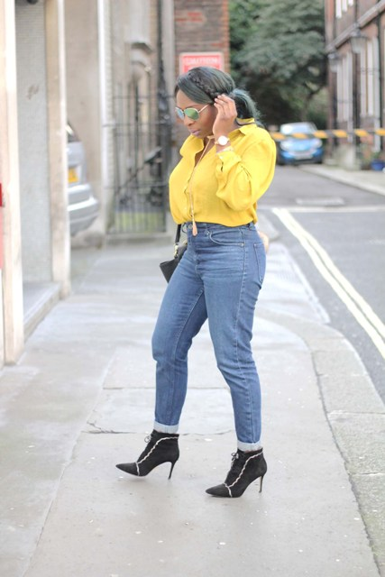With cuffed jeans, black bag and black ankle boots