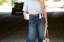 With denim culottes, white bag and printed pumps