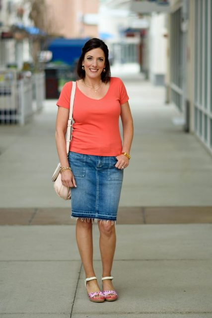 With denim knee-length skirt, t-shirt and white bag