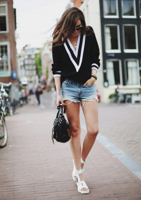 With denim shorts, white sandals and black bag