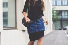 With denim skirt, black dress, black hat and chain strap bag