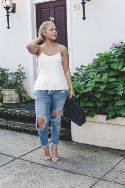 With distressed jeans, beige shoes and black bag