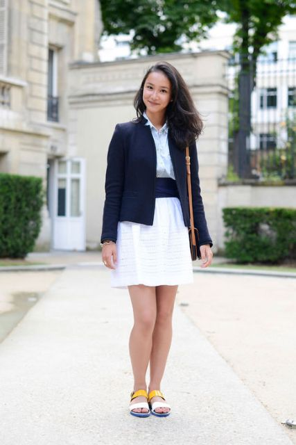 With dress, belt, navy blue blazer and brown bag