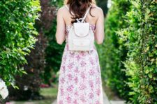 With floral maxi dress, wide brim hat and red sandals