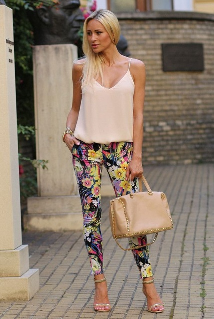 With floral pants, high heels and beige bag