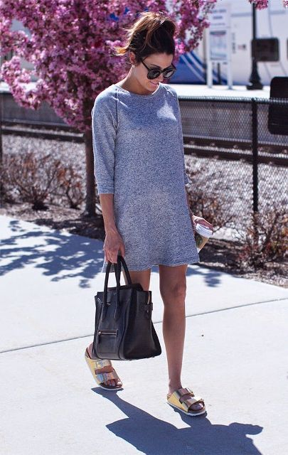 With gray mini dress and black tote