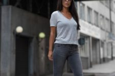 With gray skinny jeans and high heels