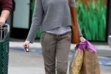 With gray sweatshirt, brown tote and gray pants