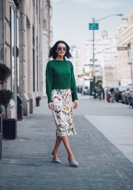 With green shirt, floral skirt and bag