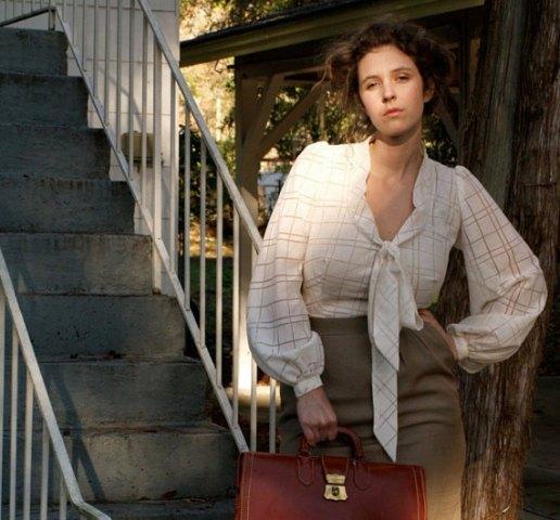 With high waisted skirt and brown bag