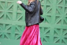 With hot pink midi skirt and leather jacket