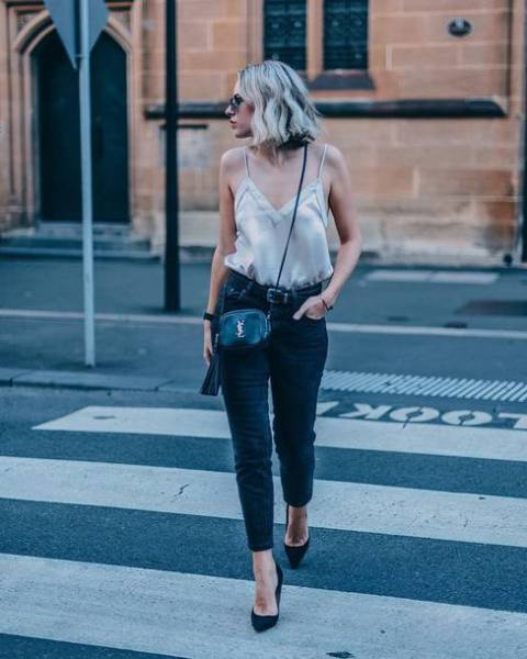 With jeans, black shoes and black leather mini bag
