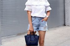 With lace blouse, lace up flats and leather bag