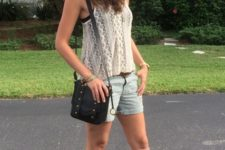 With lace top, denim shorts, hat and black bag