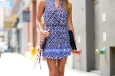 With lace up flat sandals and purple fringe bag