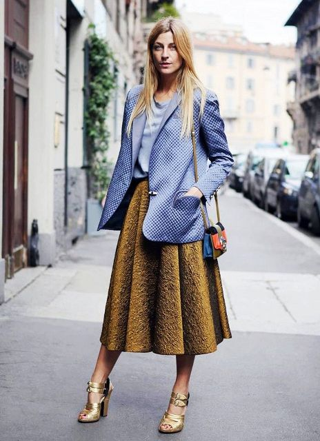 With light blue blouse, midi skirt, oversized blazer and mini bag