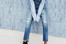 With light blue off the shoulder shirt and lace up flat boots