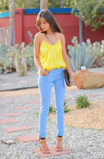 With light blue pants, black and brown shoes and black clutch