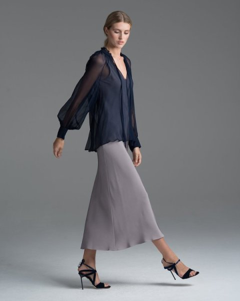 With maxi skirt and black high heels