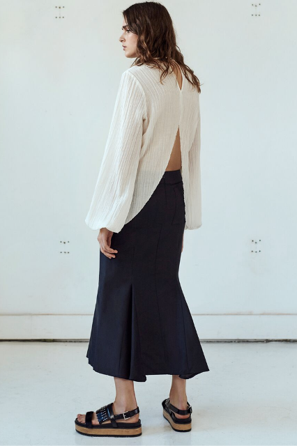 With maxi skirt and flat sandals
