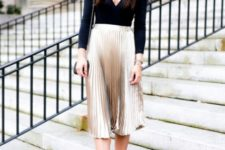 With metallic pleated skirt, pumps and mini bag