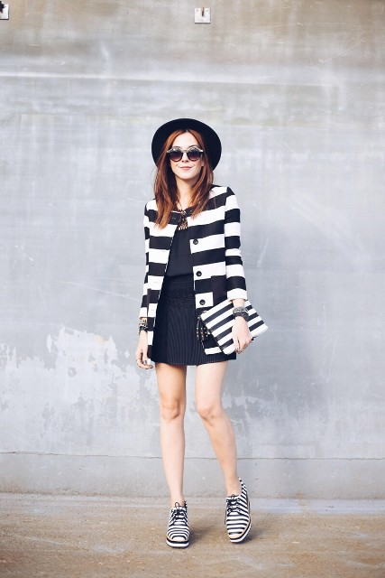 With mini skirt, shirt, striped long jacket, black hat and striped clutch