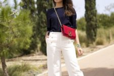 With navy blue blouse, white culottes and red chain strap bag