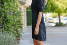 With navy blue shirtdress
