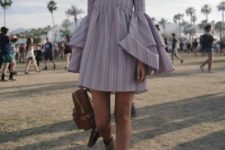 With off the shoulder dress and gray boots